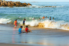 Asian children, swim, Vietnam beach Royalty Free Stock Photo