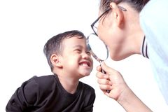 Asian children toothy smiling face with happiness emotion and fe. Male dentist close up magnifier lens to teeth Stock Photo