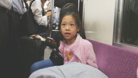 Asian children travelling on train. Cute Asian children travelling on train in rush hour stock footage