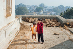 Asian children walk on the roof Stock Photos