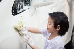 Asian children washing car Stock Photos