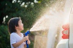 Asian children washing car Stock Photo