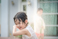 Asian children washing car Stock Photography