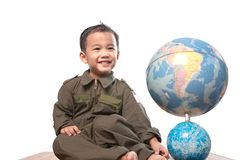 Asian children wearing military pilot suit toothy smiling face w Royalty Free Stock Images