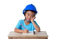 Asian children wearing safety helmet and thinking isolated on white background. Kids and education concept. Asian children wearing safety helmet and thinking stock photos