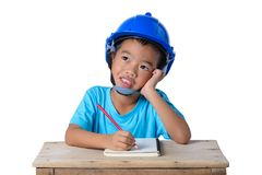 Asian children wearing safety helmet and thinking isolated on white background. Kids and education concept. Asian children wearing safety helmet and thinking royalty free stock photo