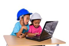 Asian children wearing safety helmet and thinking planer isolated on white background. Kids and education concept. Group of Asian children wearing safety helmet stock images