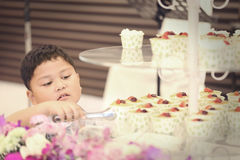 Asian children were picked cake. Vintage style of picture Stock Photography