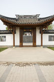 Asian China, antique buildings, doors, white walls Royalty Free Stock Image
