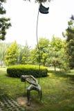Asian China, Beijing, International Sculpture Park, girl, dream, leaves Royalty Free Stock Photo