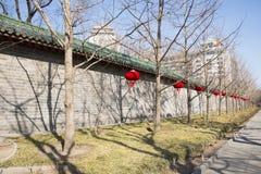 Asian China, Beijing, Yuetan Park,Wall, tree, red lanterns Royalty Free Stock Photos