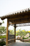 Asian Chinese antique building Pavilion. Asian Chinese Beijing Garden Expo, antique building Pavilion, wooden structure and gray tiles very elegant and very Stock Photo