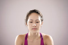 Asian chinese athlete feeling disappointed. Picture of asian chinese athlete feeling disappointed. looking downwards Stock Photos