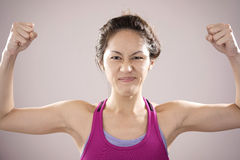 Asian chinese athlete feeling motivated. Picture of asian chinese athlete feeling motivated and raising her fists Stock Image