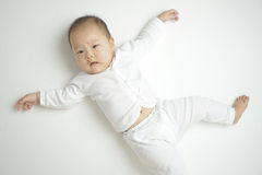 Asian chinese baby in a cute comical pose Stock Photography