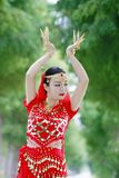Asian Chinese beauty belly dancer dancing Royalty Free Stock Photo