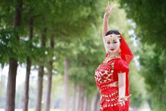 Asian Chinese beauty belly dancer in red India stytle dress Royalty Free Stock Photography