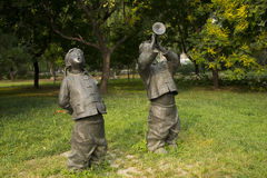 Asian Chinese, Beijing, International Sculpture Park, sculpture,Play the suona, singing folk songs, children Royalty Free Stock Photo