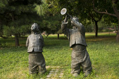 Asian Chinese, Beijing, International Sculpture Park, sculpture,Play the suona, singing folk songs, children Stock Photography