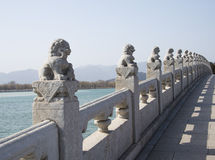 Asian Chinese, Beijing, the Summer Palace, seventeen hole  bridge, stone lion Royalty Free Stock Images