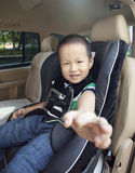 Asian chinese boy in the car with smile Stock Photo