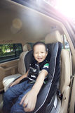 Asian chinese boy in the car with smile Royalty Free Stock Image
