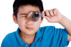 Asian Chinese Boy Holding Magnifying Glass Stock Images