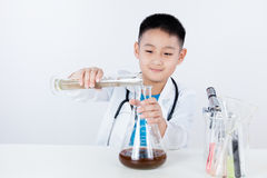 Asian Chinese boy holding test tube for research Stock Photo