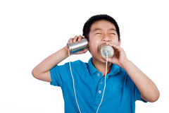 Asian Chinese Boy Playing with Tin Can Phone Stock Photos