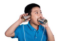 Asian Chinese Boy Playing with Tin Can Phone Stock Photo