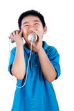 Asian Chinese Boy Playing with Tin Can Phone Royalty Free Stock Photo