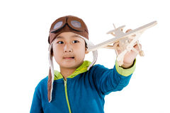 Asian Chinese Boy Playing with Wooden Airplane Royalty Free Stock Photo