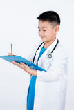 Asian Chinese boy pretending as doctor with clipboard Stock Images