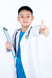 Asian Chinese boy pretending as doctor with thumbs up. In isolated plain white background royalty free stock photography
