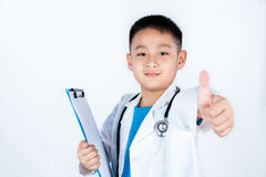 Asian Chinese boy pretending as doctor with thumbs up Royalty Free Stock Image