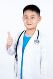 Asian Chinese boy pretending as doctor with thumbs up Stock Photography
