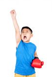 Asian Chinese boy wearing boxing gloves with victory Stock Photo
