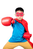 Asian Chinese boy wearing super hero costume with boxing gloves Stock Images