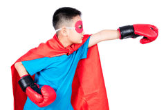 Asian Chinese boy wearing super hero costume with boxing gloves Royalty Free Stock Photo