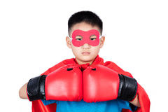 Asian Chinese boy wearing super hero costume with boxing gloves Stock Photo