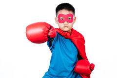 Asian Chinese boy wearing super hero costume with boxing gloves Royalty Free Stock Image