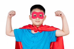 Asian Chinese boy wearing super hero costume showing muscle Royalty Free Stock Photos
