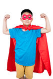 Asian Chinese boy wearing super hero costume showing muscle Stock Images