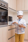 Asian Chinese Boy in white chef uniform Baking Cookies Stock Image