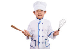 Asian Chinese Boy in White Chef Uniform Holding Baking Tools Royalty Free Stock Photography