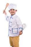 Asian Chinese Boy in White Chef Uniform Holding Baking Tools Stock Photo