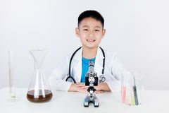 Asian Chinese boy working with microscope Stock Photo
