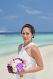 Asian chinese bride in outdoor beach photoshoot Royalty Free Stock Images