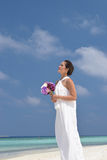 Asian chinese bride in outdoor beach photoshoot Royalty Free Stock Photography