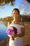 Asian chinese bride in wedding gown in nature Stock Image